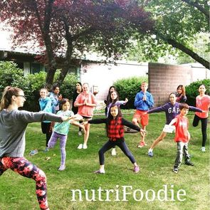 Kids doing yoga - Nature's Kitchen: cooking camp for kids in Vancouver